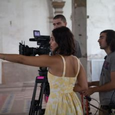 Emilie Richard-Froozan on set, giving directions