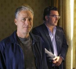 Stewart standing with Maziar Bahari